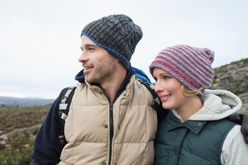 Couple on a hike in the countryside against clear sky