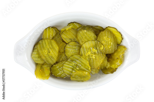Bread and butter pickles in a dish