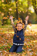 Happy boy with autumn leaves