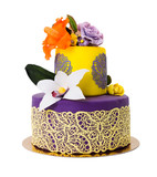 Colorful cake decorated with candy flowers and lace