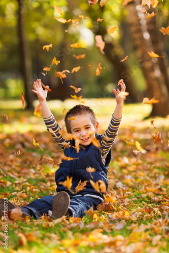 Playing with leaves in autumn