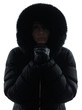 woman winter coat freezing cold silhouette