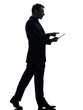 business man walking touchscreen digital tablet  silhouette