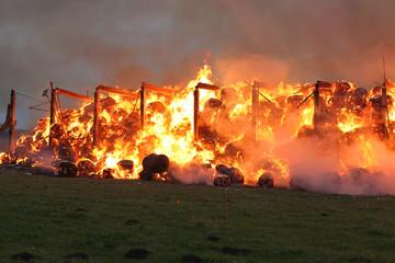 Burning farm building with hay
