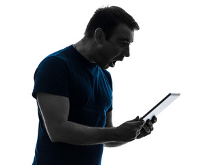 man holding digital tablet  surprised silhouette