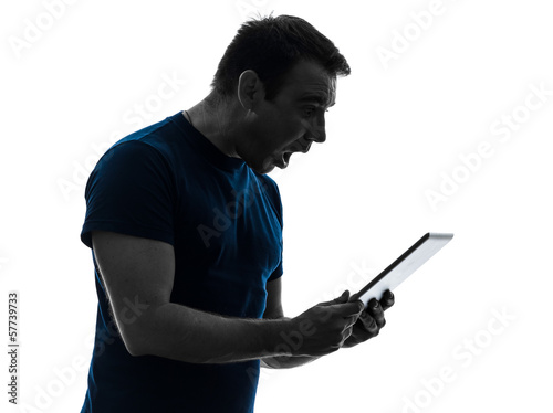 man holding digital tablet  surprised silhouette