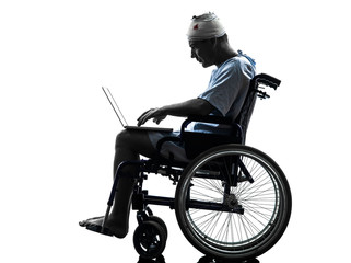 injured man in wheelchair computing laptop computer silhouette
