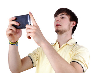 Young Man with serious look on his smartphone looks