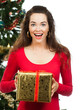 Surprised women holding Christmas present