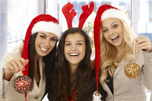 Young female office workers in santa hat