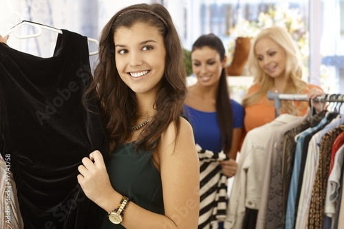 Pretty girl at clothes store