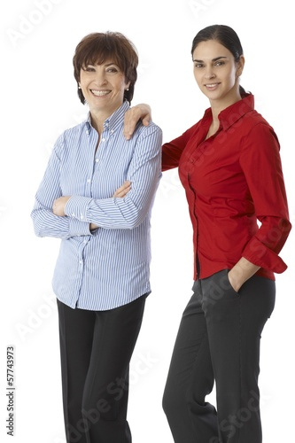 Mother and daughter smiling happy