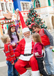 Santa Claus And Children In Courtyard
