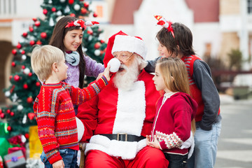Children Playing With Santa Claus's Hat
