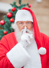 Santa Claus With Finger On Lips