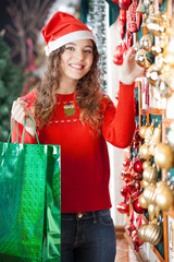 Woman With Shopping Bag Buying Christmas Ornaments