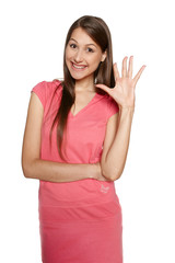 Funny image of young female waving her hand