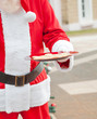 Santa Claus Holding Plate With Cookies