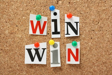 The phrase Win Win on a cork notice board
