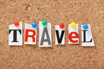 The word Travel on a cork notice board