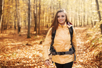 Beautiful female hiker in forest