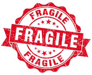 Fragile grunge round red scratched seal