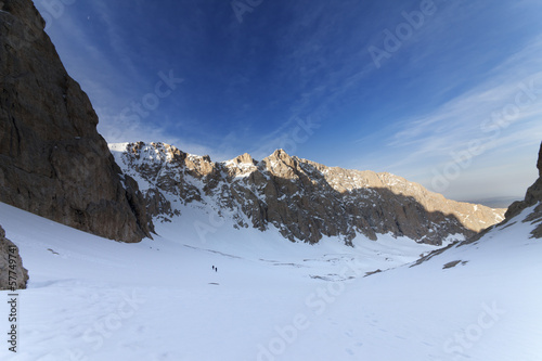 Two hikers on snowy mountains in morning
