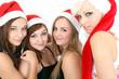 Vier frauen mit Weihnachtsmützen