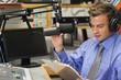 Well dressed focused radio host moderating