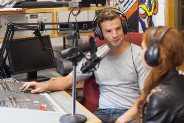 Attractive content radio host interviewing a guest