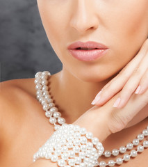 Portrait of a young and beautiful woman wearing pearls