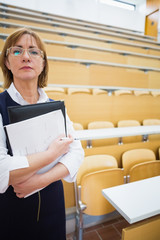 Serious elegant teacher standing in the lecture hall