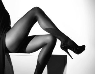 Black and white photo of beautiful legs in stockings