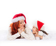 A young and happy mother and daughter in Christmas hats