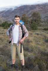 Man with backpack standing on forest landscape