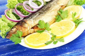 Smoked fish on plate close up