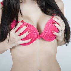 Woman getting comfortable in her bra