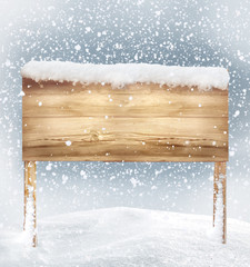 wooden signboard in snow