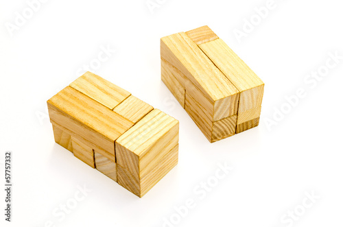 A wooden cube puzzle over white