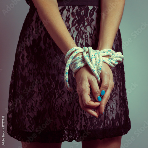 Detail of female hands tied up