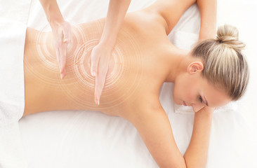 A woman getting spa treatment over white background