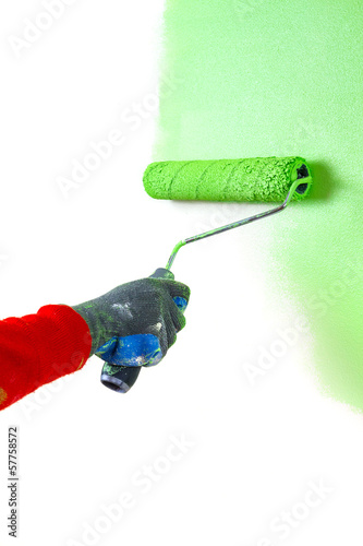 Painting white wall with paint roller