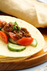 tortilla fajita wraps with beef and vegetables, Mexican food