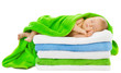Baby newborn sleeping wrapped in bath towels