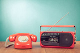 Retro telephone and old radio cassette recorder