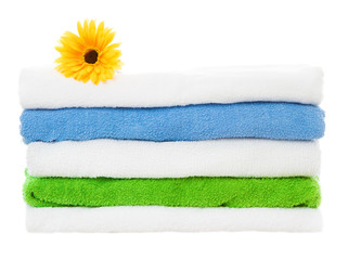 Towels stack with flower on isolated white background