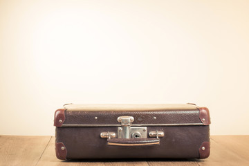Vintage old travel suitcase on floor with empty space for text