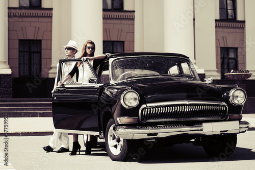Young couple at the retro car