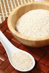 oat bran in bowl and ceramic spoon