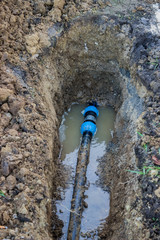 broken pvc pipe in trench  leaks water